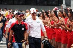 Timo Glock, Marussia F1 Team with Michael Schumacher, Mercedes AMG F1 on the drivers parade