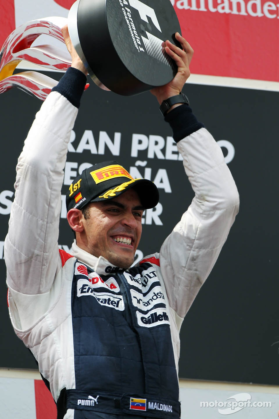 Race winner Pastor Maldonado, Williams F1 Team celebrates on the podium