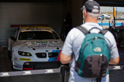 Fan admiring the #55 BMW before the race