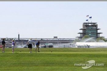 Golfers tee off with the Pagoda in the background during practice for the Indianapolis 500