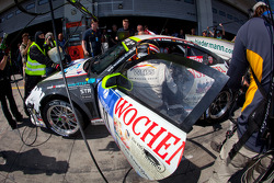 Pit stop for #11 Wochenspiegel Team Manthey Porsche 911 GT3 R: Marc Lieb, Romain Dumas, Lucas Luhr, Richard Lietz