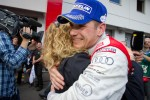 Race winner Marc Basseng celebrates with Christina Surer
