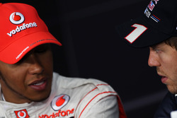 Lewis Hamilton, McLaren Mercedes with pole sitter Sebastian Vettel, Red Bull Racing in the FIA Press Conference