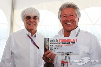 Mario Andretti presenting a VIP ticket for the 2012 United States Grand Prix to Bernie Ecclestone, CEO Formula One Group and Niki Lauda