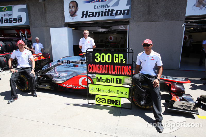 Jenson Button, McLaren Mercedes; Martin Whitmarsh, McLaren Mercedes Chief Executive Officer and Lewis Hamilton, McLaren Mercedes celebrate 300 Grands Prix with Mobil, Mercedes-Benz, and Enkei