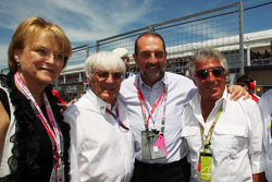 Bernie Ecclestone, CEO Formula One Group, with Mario Andretti on the grid