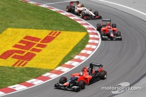 Timo Glock, Marussia F1 Team leads Charles Pic, Marussia F1 Team and Narain Karthikeyan, HRT Formula One Team HRT