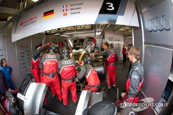 Audi Sport team members repair the #3 Audi Sport Team Joest Audi R18 Ultra