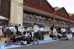 Sergio Perez, Sauber and team mate Kamui Kobayashi, Sauber in the pits