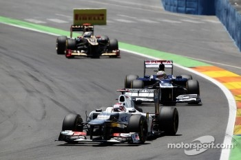 Kamui Kobayashi, Sauber leads Pastor Maldonado, Williams