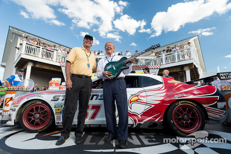 John Stevenson gets the race winner's guitar