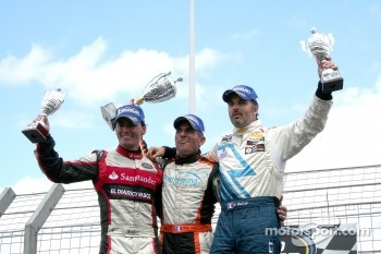 Victory lane: winner Eric Helary, second place Ander Vilarino, third place Yvan Muller