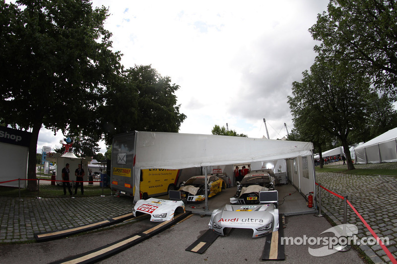 The Cars of Timo Scheider, ABT Sportsline Audi A5 DTM and Adrien Tambay, Audi Sport Team Abt Audi A5 DTM sit in the Team ABT tent
