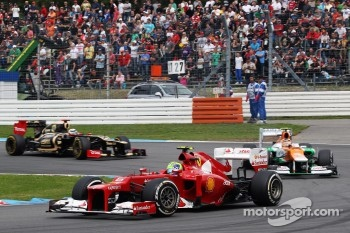 Felipe Massa, Scuderia Ferrari leads Nico Hulkenberg, Sahara Force India F1 and Kimi Raikkonen, Lotus F1