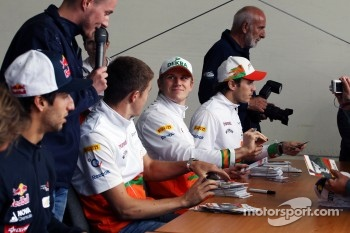 Daniel Ricciardo, Scuderia Toro Rosso; Paul di Resta, Sahara Force India F1; Nico Hulkenberg, Sahara Force India F1 and Jules Bianchi, Sahara Force India F1 Team Third Driver sign autographs for the fans