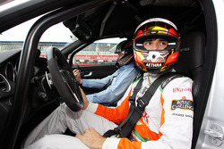 Jules Bianchi, Sahara Force India F1 Team Third Driver gives a taxi ride to Byron Young, Journalist around the circuit