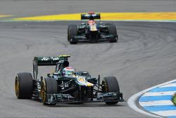 Vitaly Petrov, Caterham leads Heikki Kovalainen, Caterham