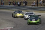 Porsches through turn one