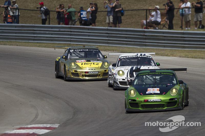 Porsches through turn one