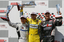 Podium: second place Takuma Sato, Rahal Letterman Lanigan Honda, winner Helio Castroneves, Team Penske Chevrolet and third place Will Power, Verizon Team Penske Chevrolet