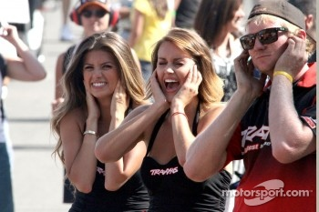 Paddock beauties react to the noise of the burnout.