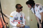 Lewis Hamilton, McLaren on his mobile phone in the pits