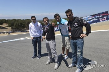 Loris Capirossi gives pointers to Michele Pirro, Honda Gresini and friends