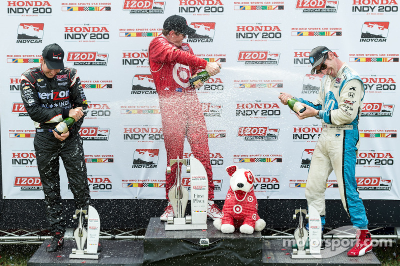 Race winner Scott Dixon, second place Will Power and third place Simon Pagenaud spray champagne
