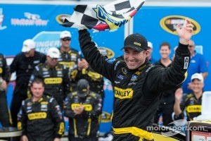 Victory lane: race winner Marcos Ambrose celebrates