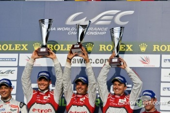Andre Lotterer, Benoit Trluyer, Marcel Fssler proudly raise their trophies