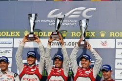 Andre Lotterer, Benoit Tréluyer, Marcel Fässler proudly raise their trophies