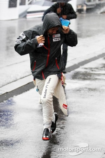 Kamui Kobayashi, Sauber runs during a heavy rain shower