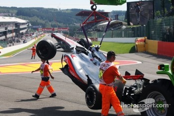 The McLaren of Lewis Hamilton, McLaren is craned away after a crash at the start