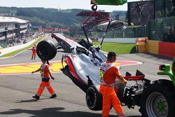 The McLaren of Lewis Hamilton, McLaren is craned away after a crash at the start