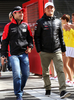 Timo Glock, Marussia F1 Team and Nico Rosberg, Mercedes AMG F1 on the drivers parade