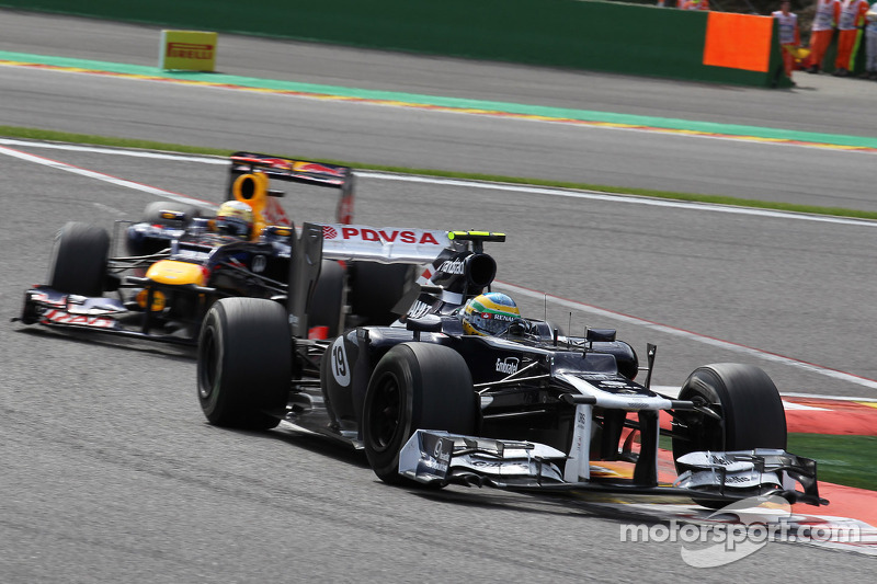 Bruno Senna, Williams F1 Team leads Sebastian Vettel, Red Bull Racing