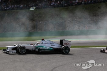 Michael Schumacher, Mercedes AMG Petronas drives into the pits