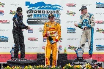 Race winner Ryan Hunter-Reay, second place Ryan Briscoe and third place Simon Pagenaud spray champagne
