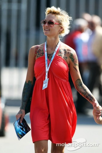 A tattooed woman in the paddock