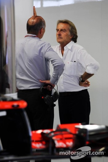 Ron Dennis, McLaren Executive Chairman with Luca di Montezemolo, Ferrari President in the McLaren pits