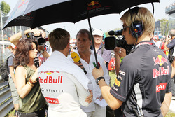 Sebastian Vettel, Red Bull Racing on the grid with Kai Ebel, RTL TV Presenter