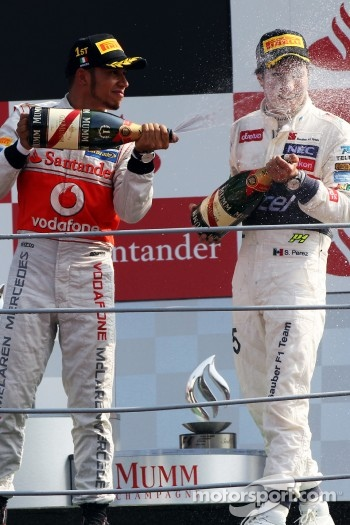 Podium: race winner Lewis Hamilton, McLaren, second place place Sergio Perez, Sauber F1 Team