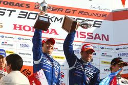 Race winners Joao Paulo de Oliveira and Tsugio Matsuda celebrate