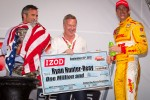 IndyCar Series 2012 champion Ryan Hunter-Reay, Andretti Autosport Chevrolet is presented with his championship check