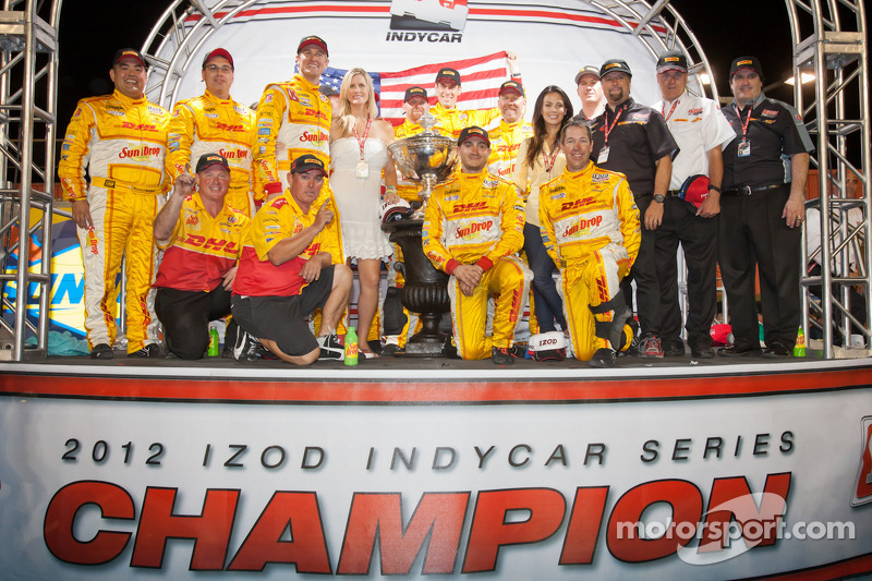 IndyCar Series 2012 champion Ryan Hunter-Reay, Andretti Autosport Chevrolet celebrates with his wife Becky, Michael Andretti and Andretti Autosport team members