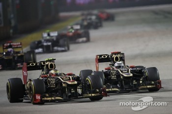 Romain Grosjean, Lotus F1 battles for position with his team mate Kimi Raikkonen, Lotus F1