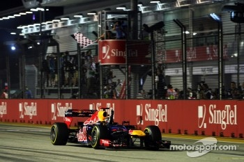 Race winner Sebastian Vettel, Red Bull Racing celebrates as he takes the chequered flag at the end of the race