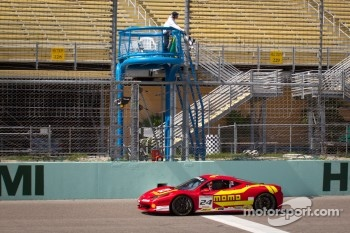 #24 Ferrari of Beverly Hills 458TP: Carlos Kauffmann takes the checkered flag to win the race