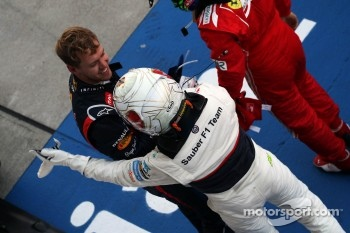 Kamui Kobayashi, Sauber celebrates his third position in parc ferme with race winner Sebastian Vettel, Red Bull Racing