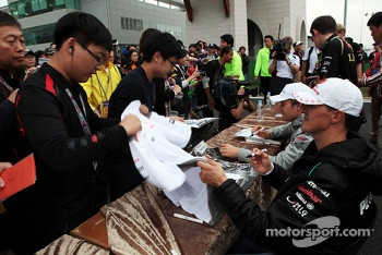 Michael Schumacher, Mercedes AMG F1 signs autographs for the fans